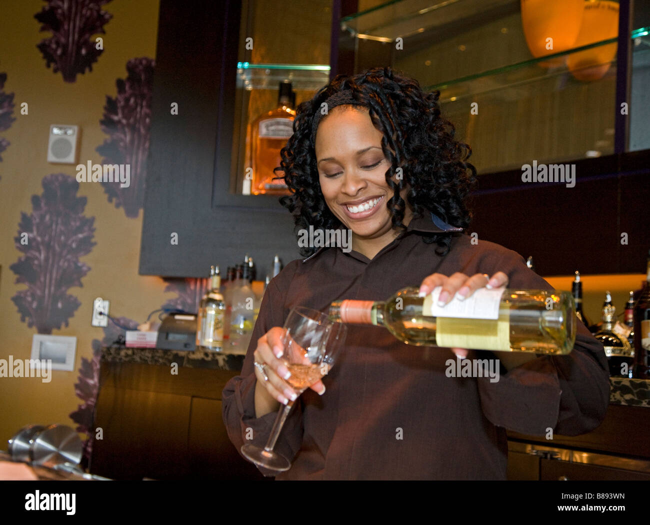 Detroit Michigan A bartender pours a glass of wine at the Bistro 555 restaurant in the Greektown Casino Hotel - Stock Image