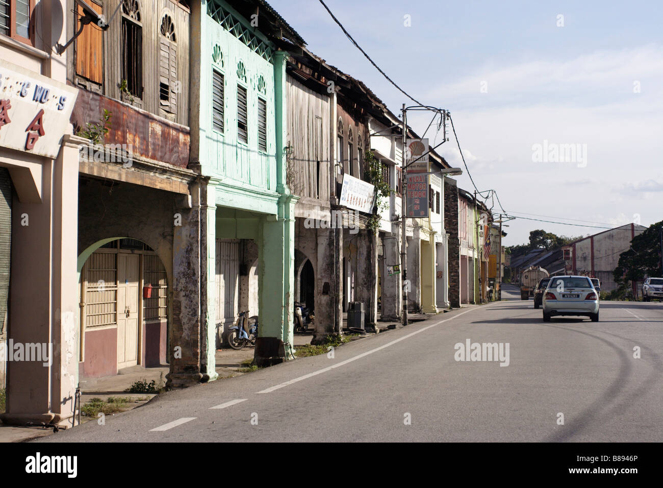 Old shophouses along country road in West Malaysia. - Stock Image