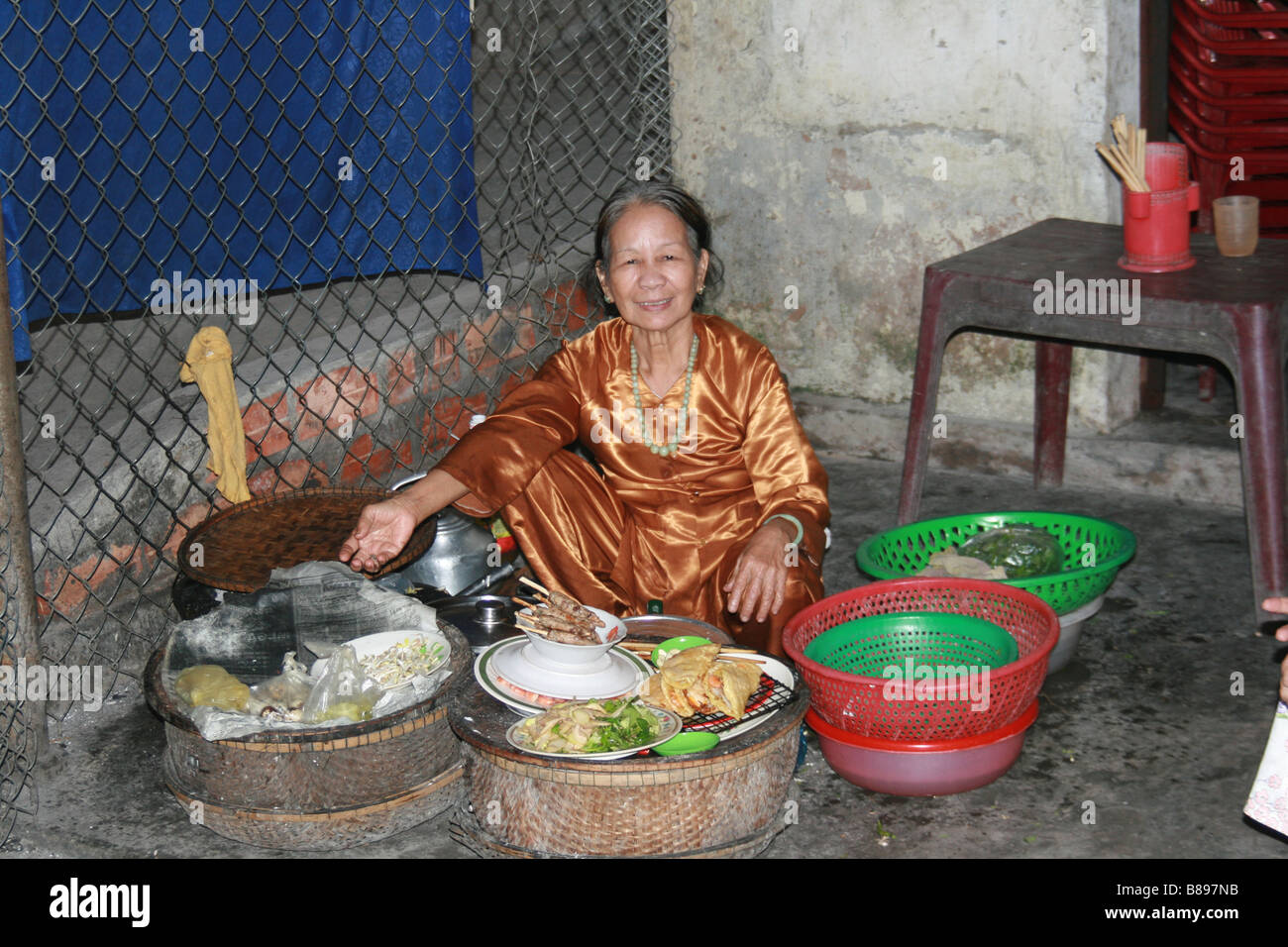 Photograph of a lady and her stall at a market in Hoi Ann Vietnam - Stock Image