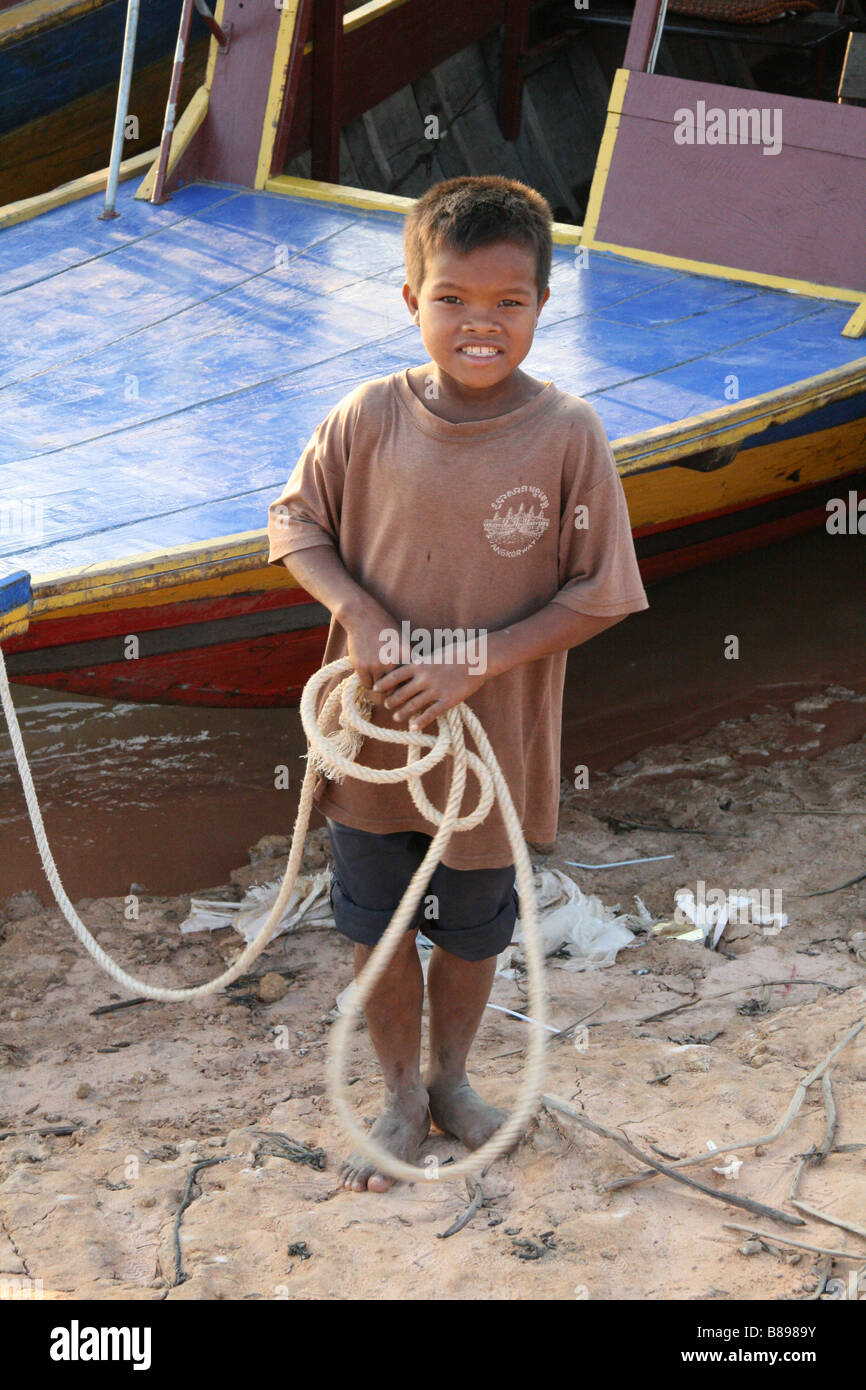 Photograph of a cute Cambodian boy taken by Tonle Sap lake near Siem Reap in Cambodia - Stock Image