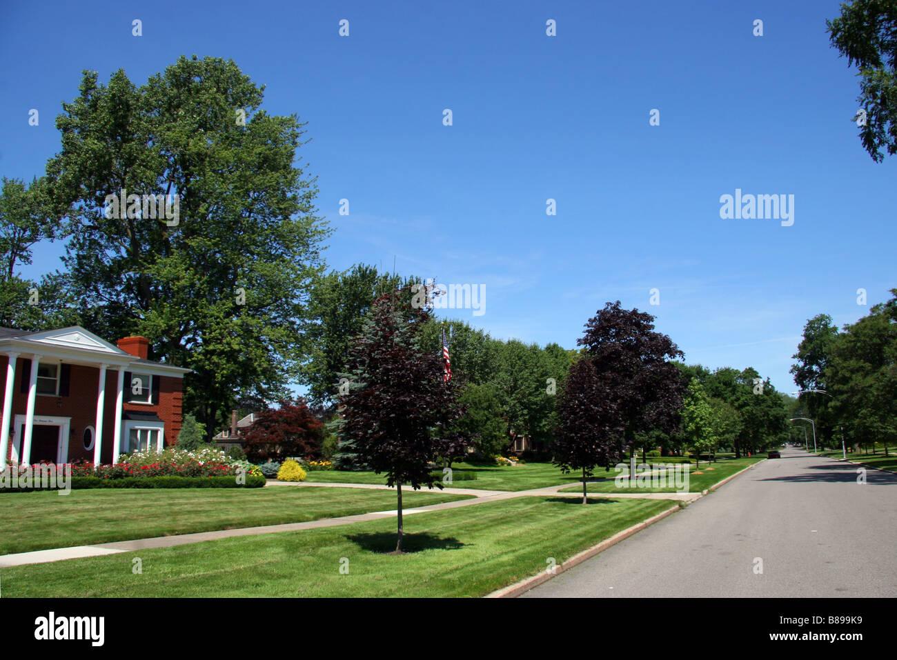Green street in an affluent neigbourhood of Grosse Pointe Michigan USA - Stock Image