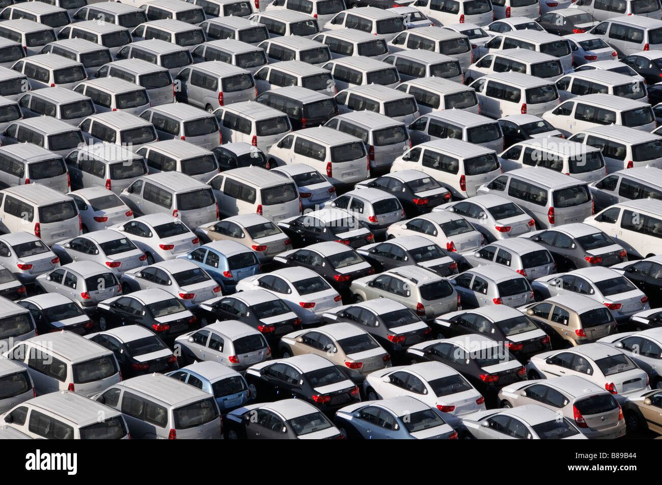 Bahrain looking down close up on dockside storage of imported new cars in parking lot awaiting distribution - Stock Image