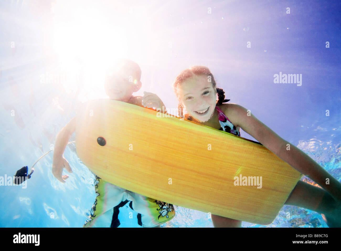 kids swimming underwater - Stock Image