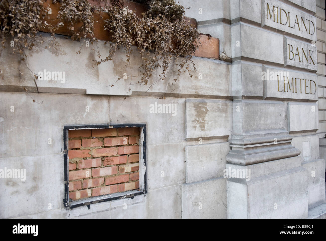 Bricked in cash dispenser at former branch of Midland Bank, London UK - Stock Image