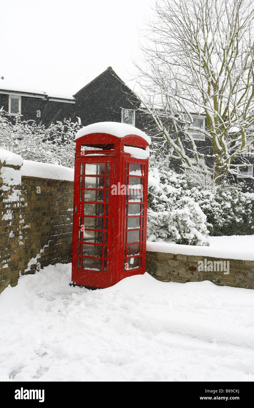 Red Telephone Box in snow Taken February Waltham Abbey Essex UK - Stock Image