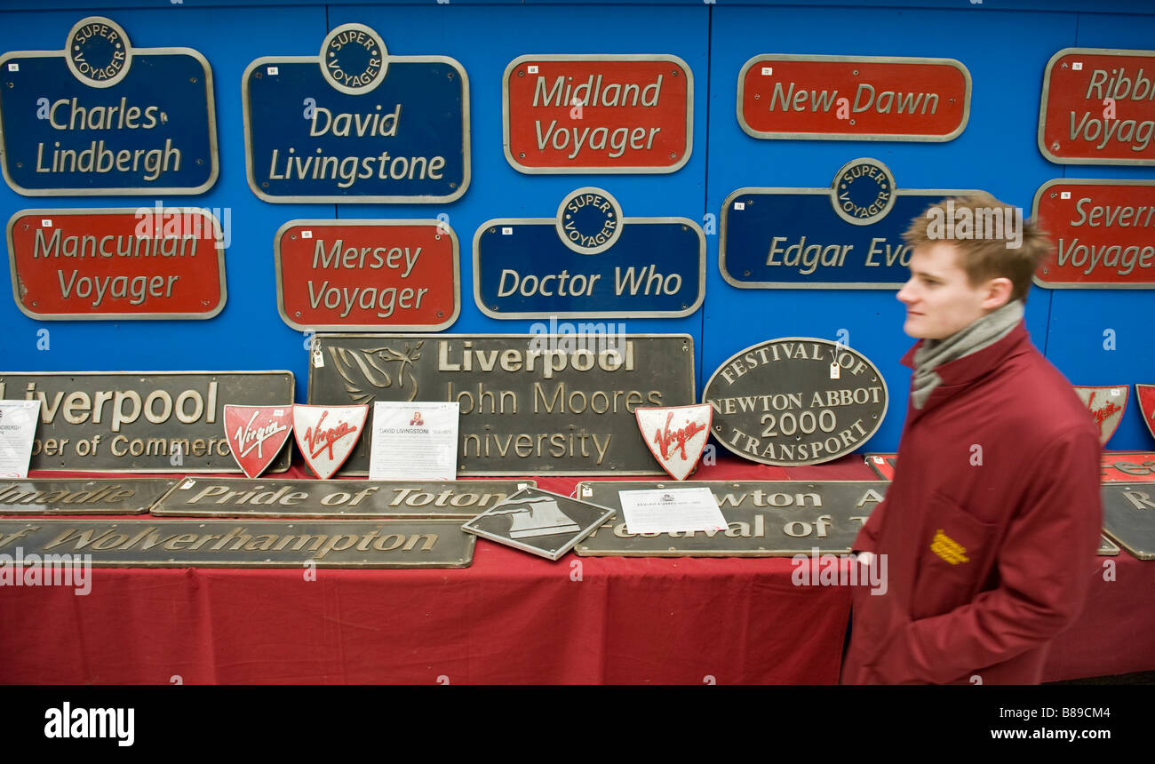 Virgin trains nameplates displayed on a wall at an auction in Waterloo Station, London - Stock Image