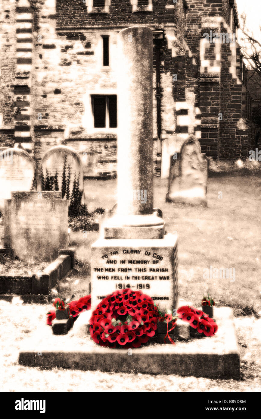 War memorial and poppy wreaths. UK. (Vintage grainy effect). - Stock Image