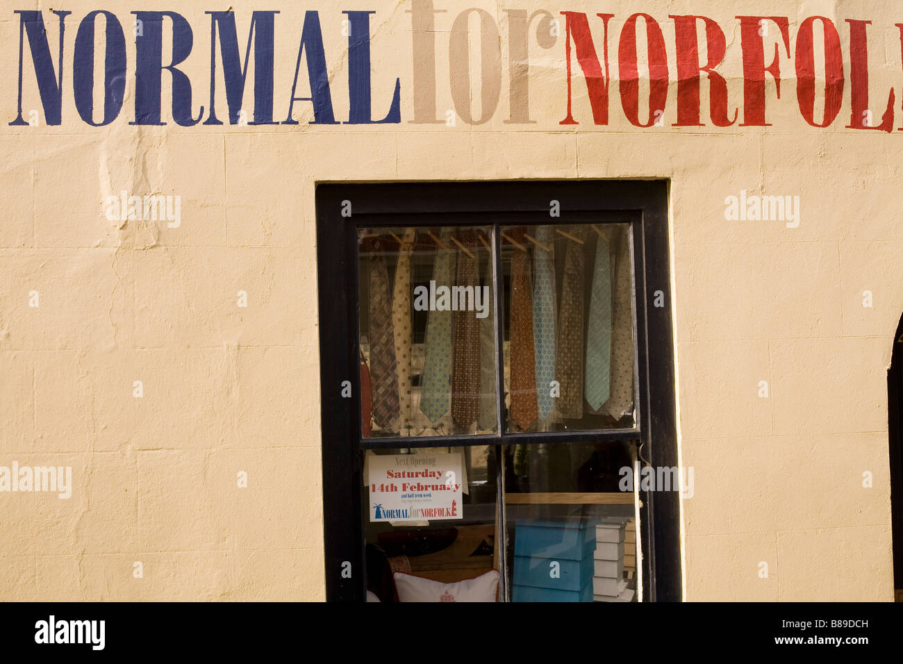 'Normal for Norfolk' sign above small shop in Norfolk - Stock Image