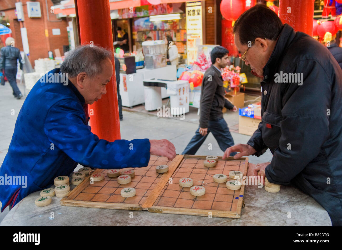 Two men playing a game of chinese checkers in Chinatown London UK Stock Photo