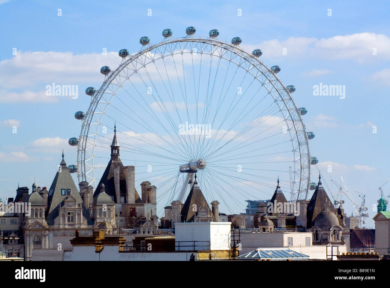 The London eye seen across the Rooftops of Westminster - Stock Image