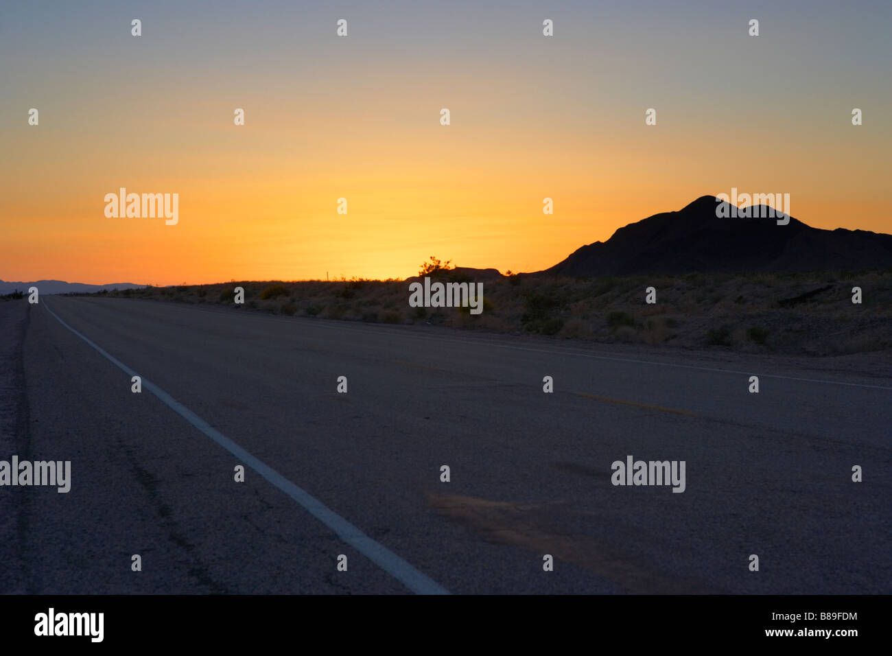 Deserted road in Mojave Desert California United States of America - Stock Image