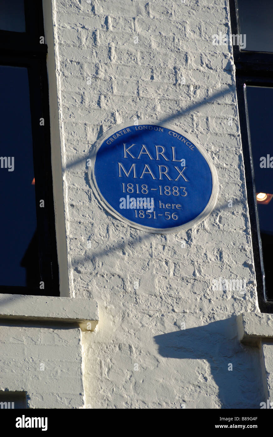 Blue Plaque marking the house where Karl Marx lived in Dean Street Soho London - Stock Image