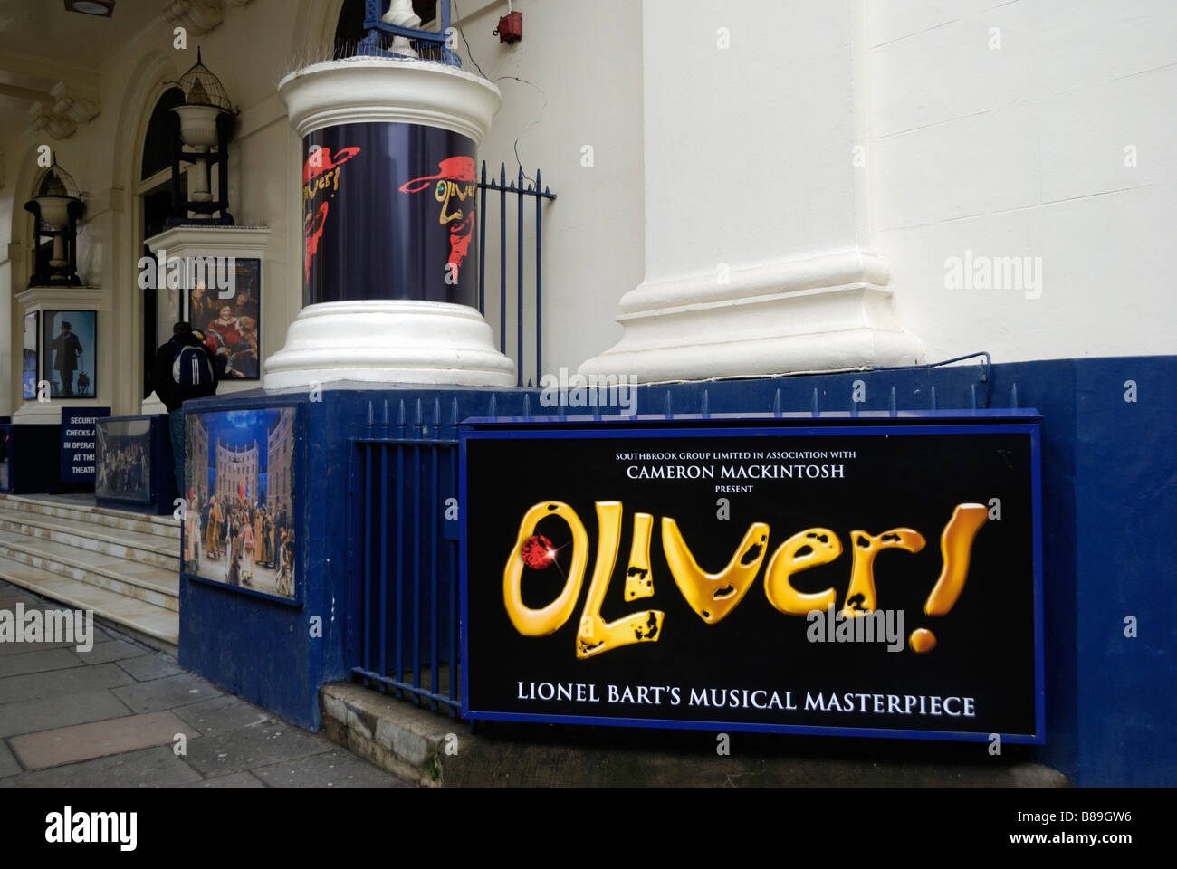 Billboards advertising the stage musical Oliver outside the Theatre Royal Drury Lane Covent Garden London Stock Photo