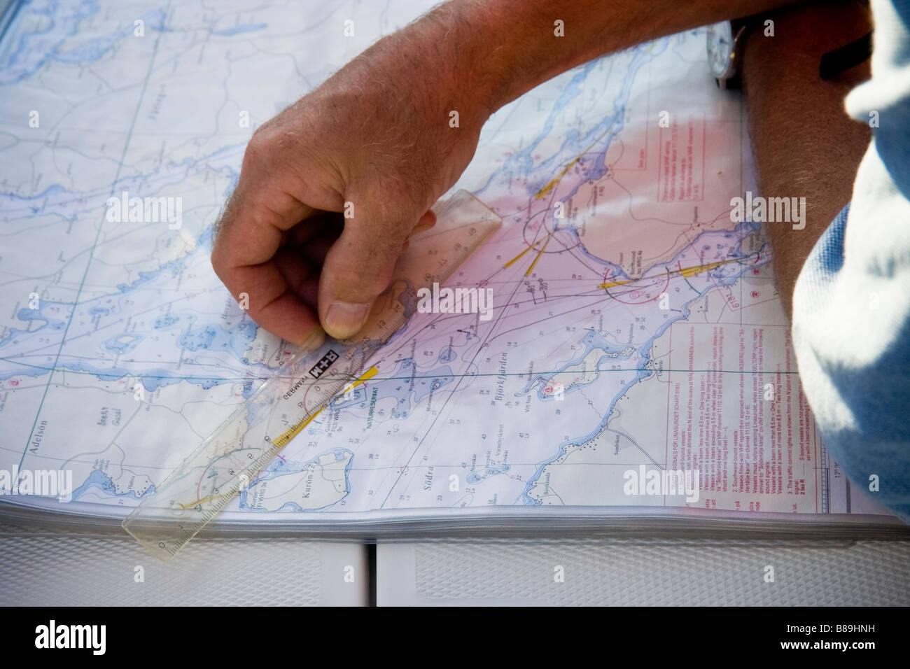 Calculating distance on nautical chart - Stock Image
