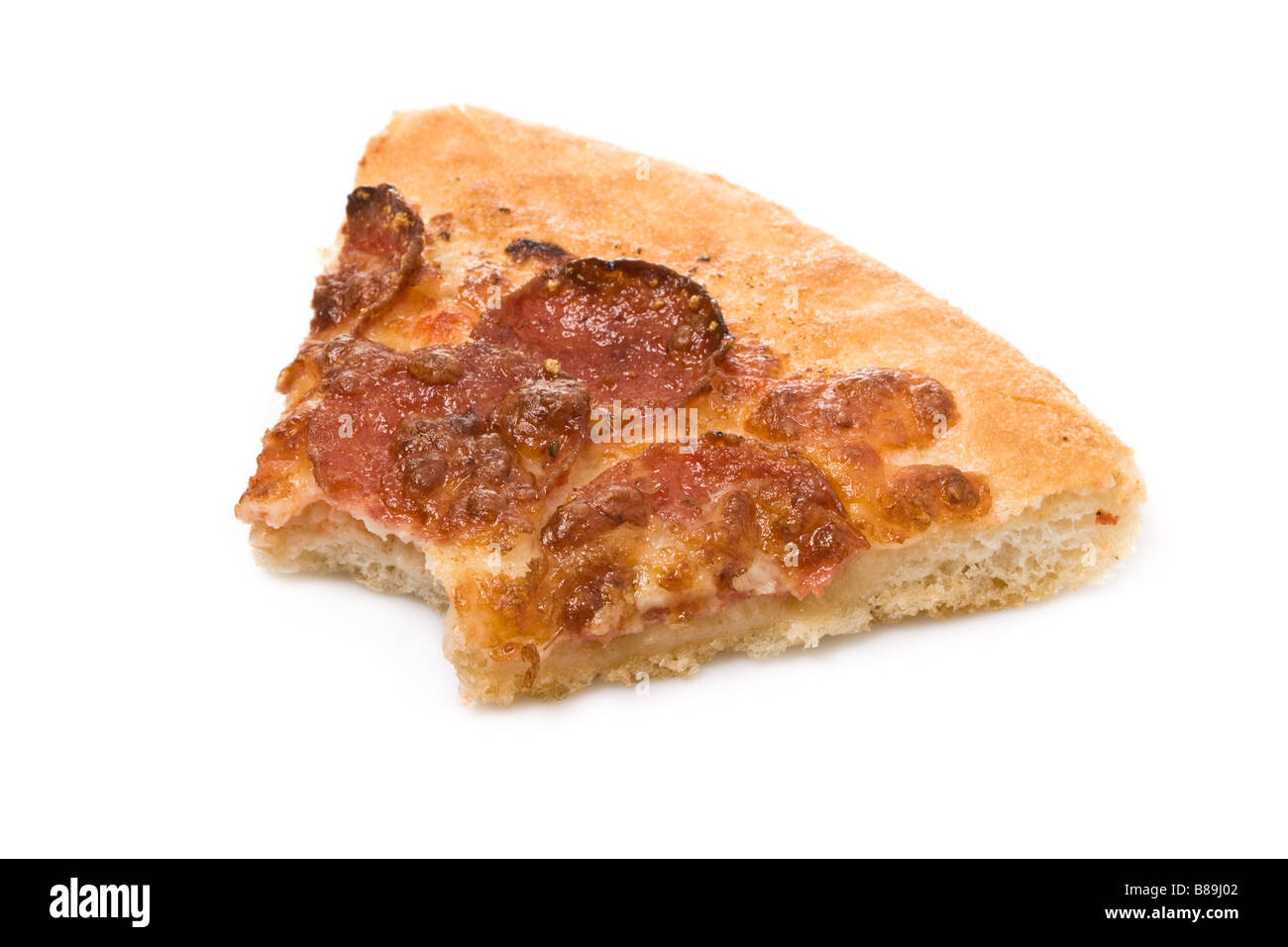 Bitten pepperoni pizza slice leftovers isolated on white background. cut out cutout fast food junk bite eaten cheese - Stock Image