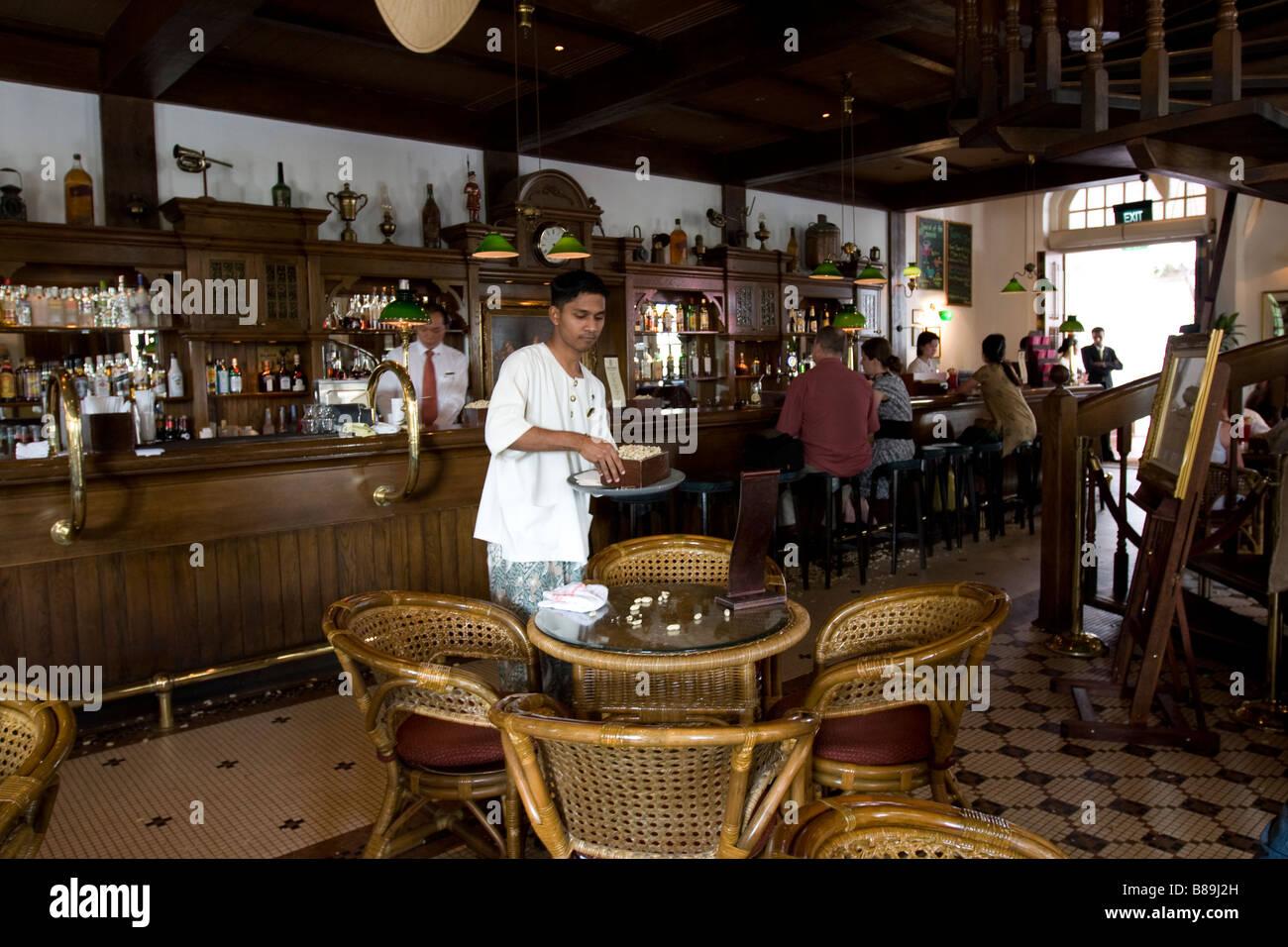 The Long bar at Raffles hotel Singapore - Stock Image