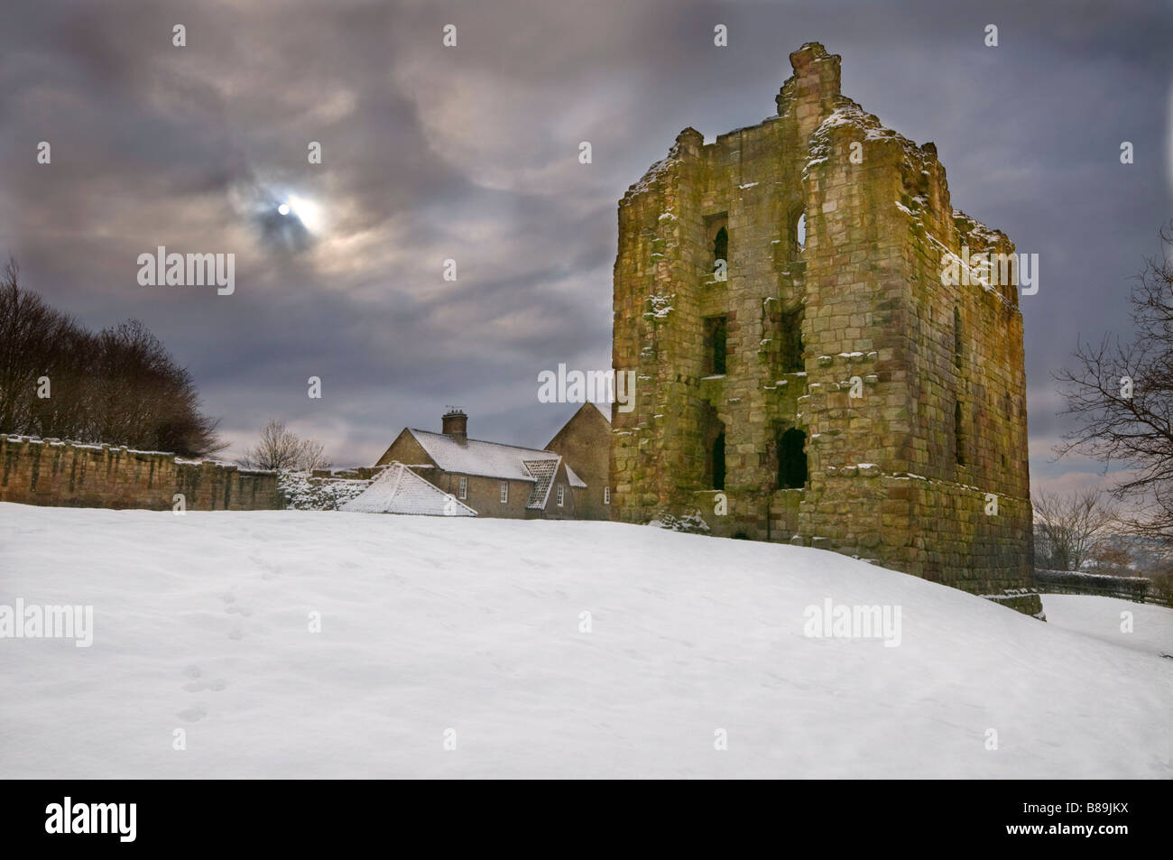 Winter and the snow lies all around the keep of Etal Castle Stock Photo