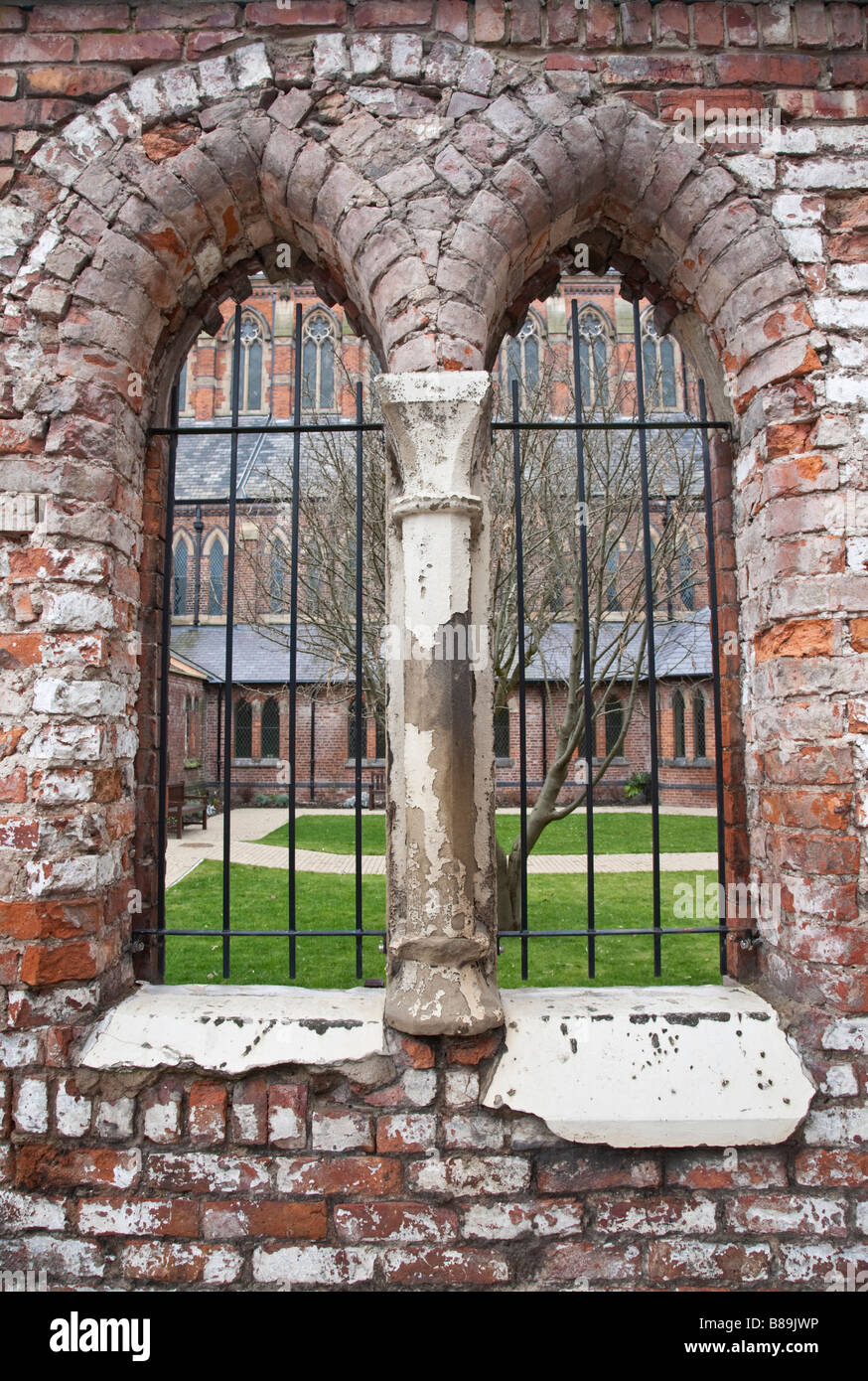 Looking through windows into the cloisters. Gorton Monastery, Gorton, Greater Manchester, United Kingdom. - Stock Image