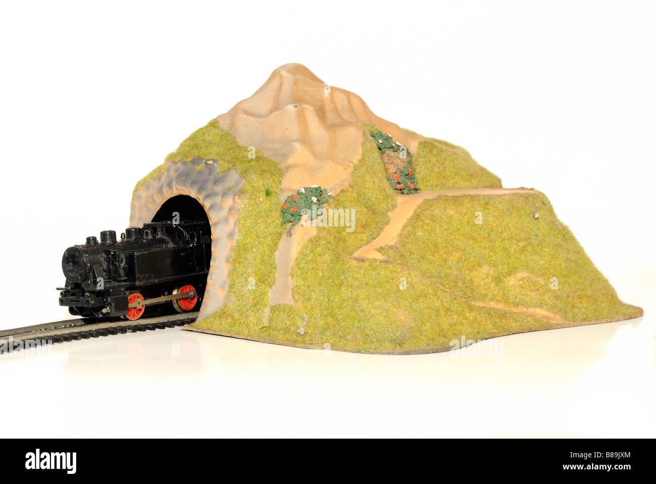 Steam locomotive engine model railway tunnel cut out still life - Stock Image