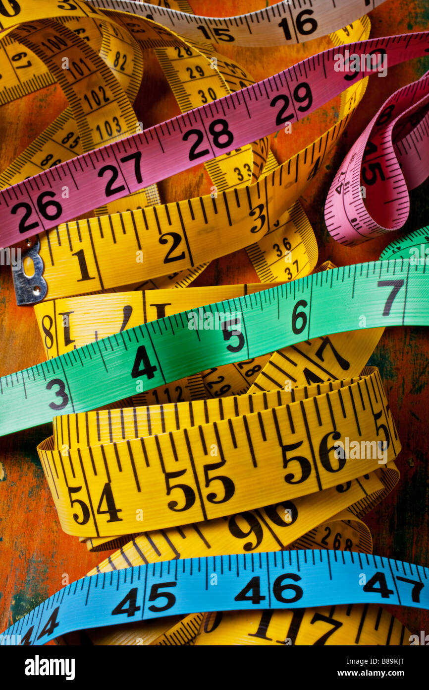 Different colored tape measures - Stock Image