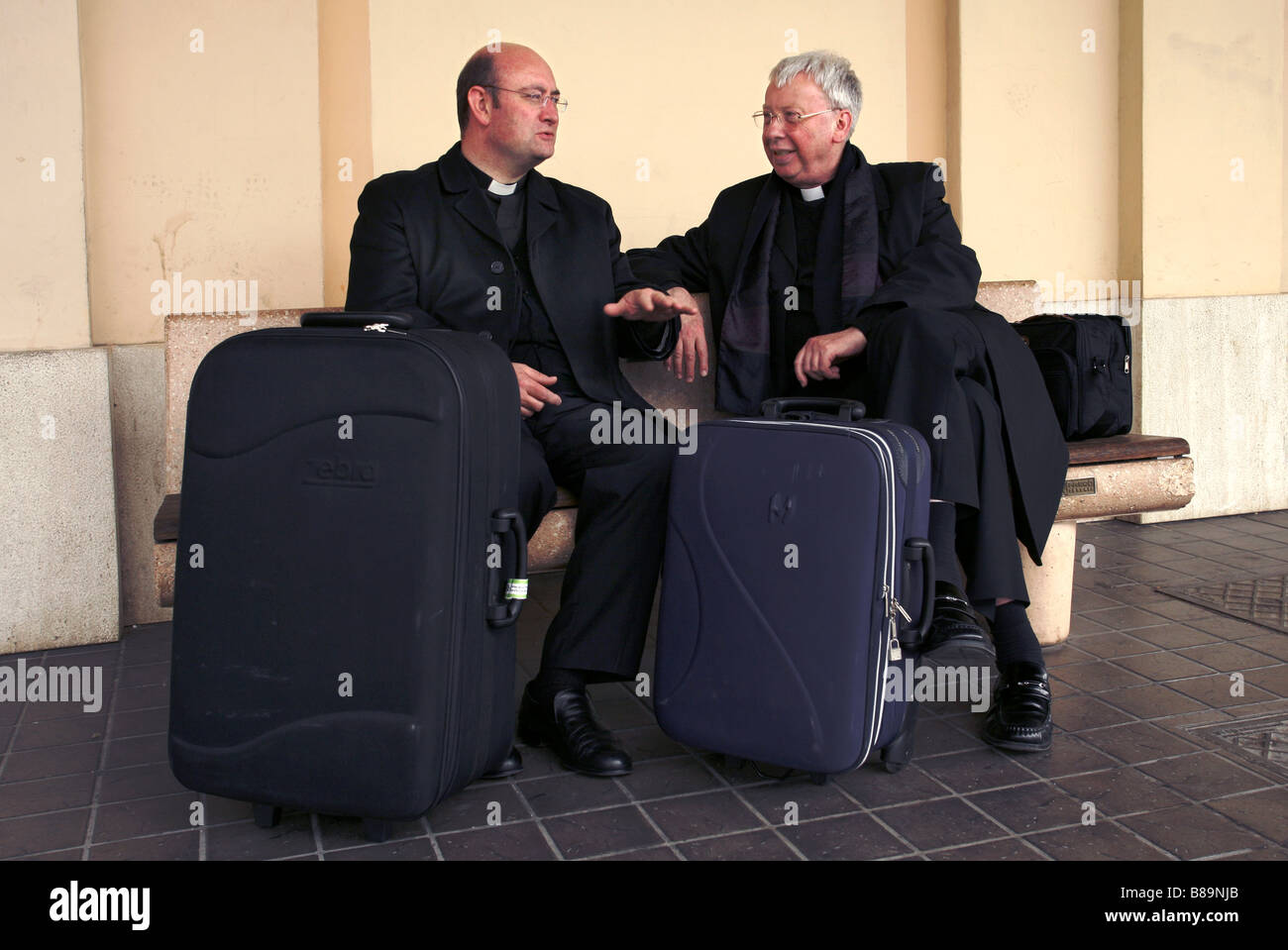 Catholic Priests, Assisi Train Station, Assisi, Umbria, Italy - Stock Image