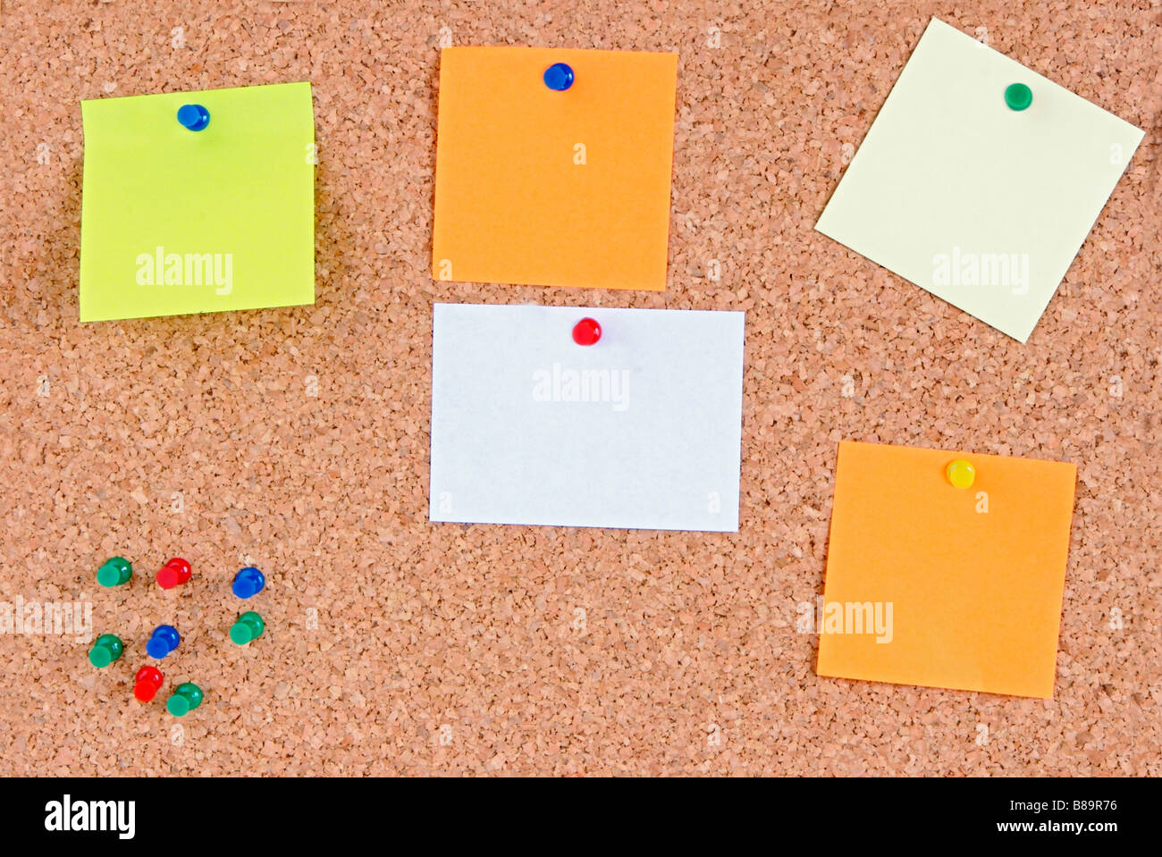 Cork bulletin board with notes in blank - Stock Image