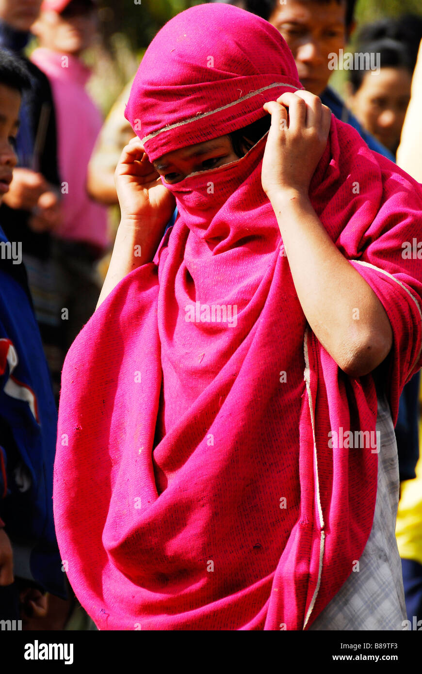 Karen kid with pink clothe cover her face from the sun,Tak,Northern Thailand. - Stock Image