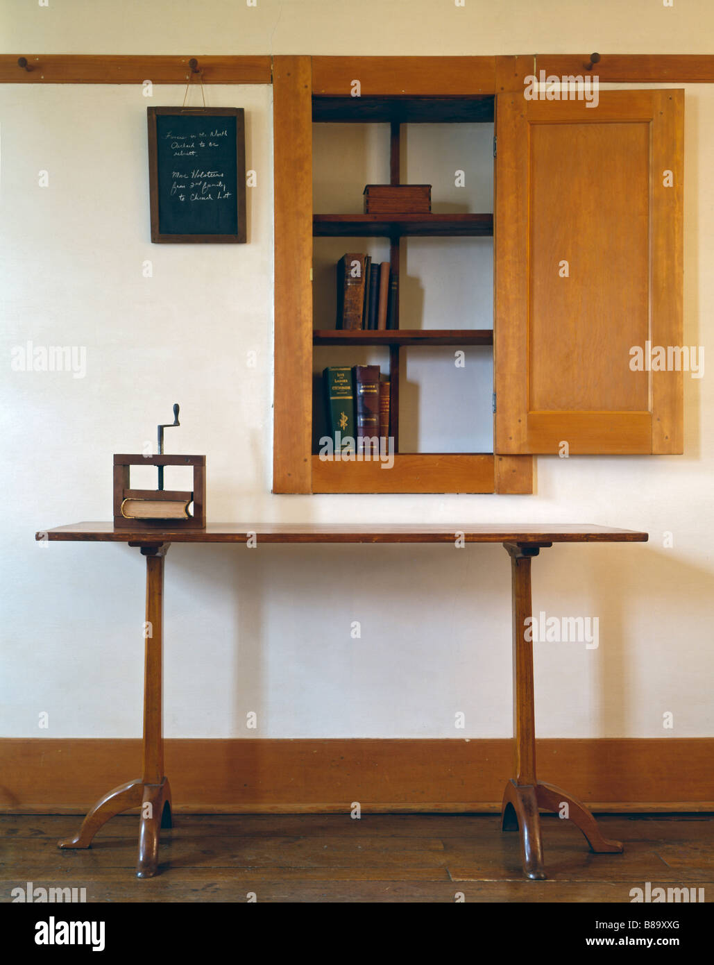 Shaker table and built in cupboard at Hancock Shaker community in Massachussetts - Stock Image