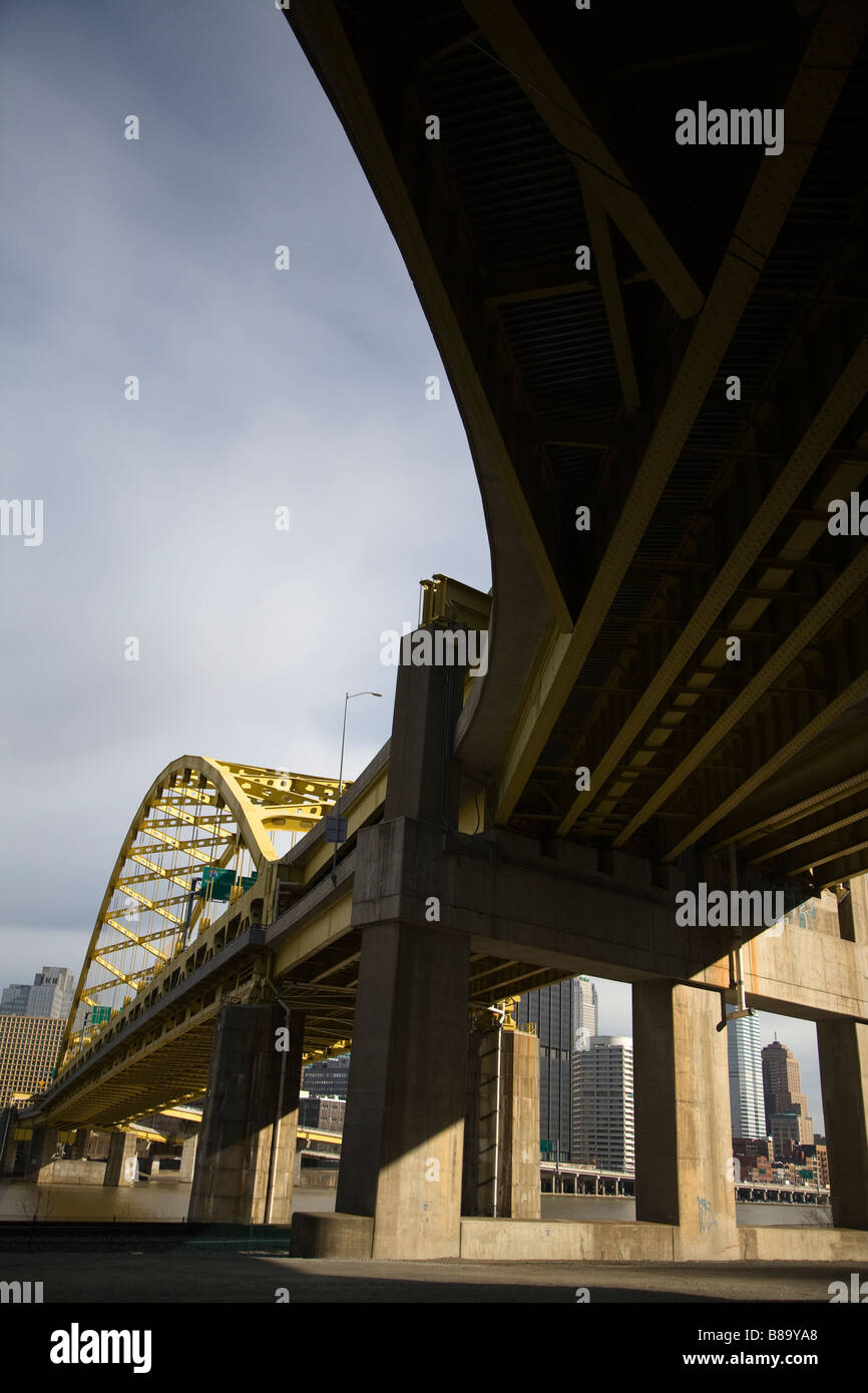 Underneath the Fort Pitt Bridge which crosses the Monongahela River Pittsburgh Pennsylvania USA Stock Photo