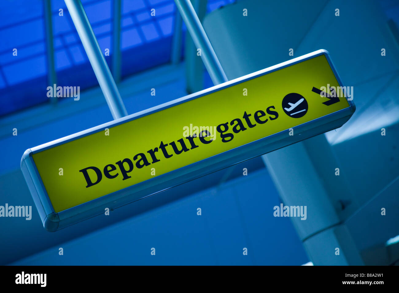 Departure Gates sign with arrow at Gatwick Airport, London - Stock Image