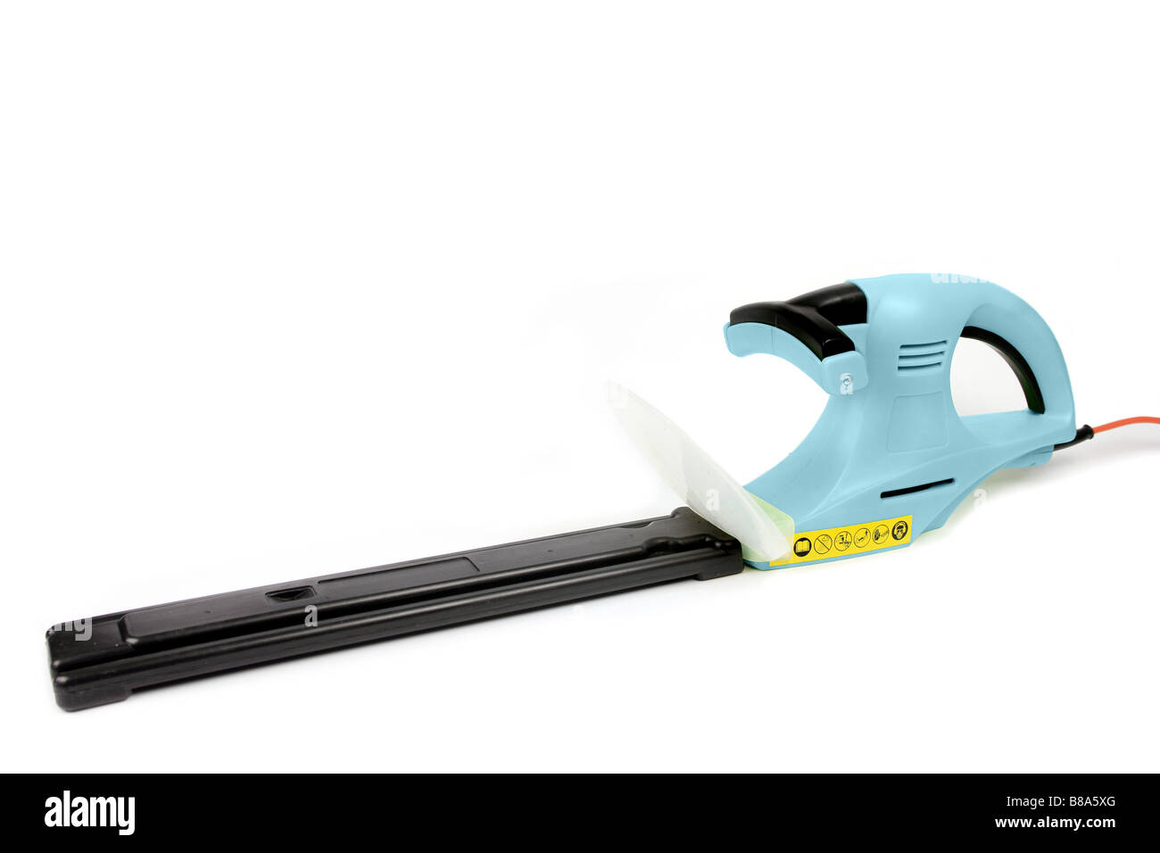 Electric garden hedge trimmer with its cutting blade sheath attached set against a white background - Stock Image