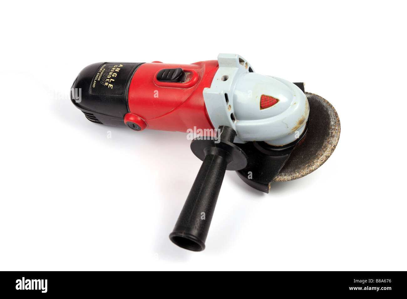 Hand held Electric Angle Grinder against a white background - Stock Image
