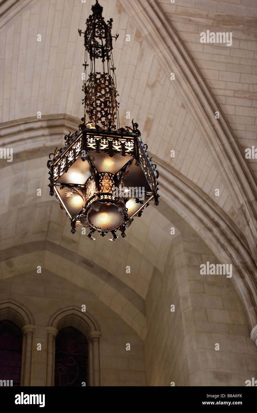 A chandelier and stained glass window in a cloister of the national cathedral washington dc