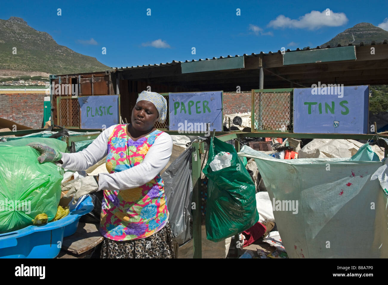Woman working at a collecting point for recycling in Hout Bay near Cape Town South Africa Stock Photo
