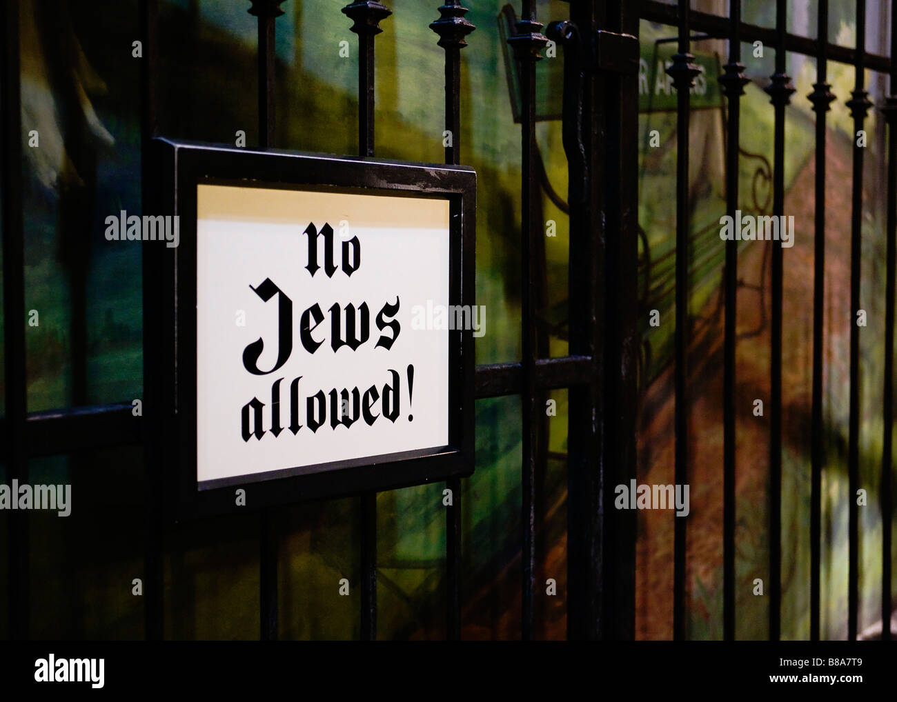No Jews Allowed sign on fence - Stock Image