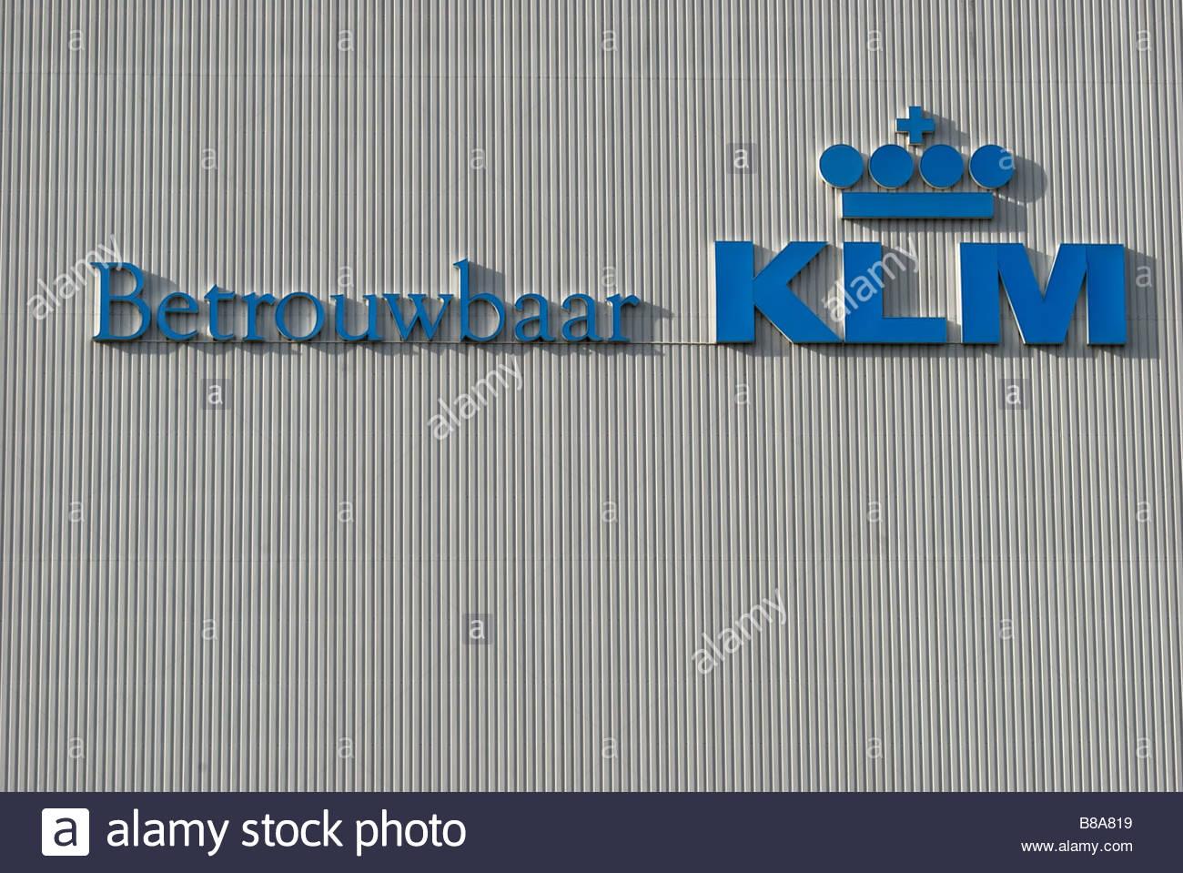Schiphol The Netherlands 'Betrouwbaar KLM' Reliable KLM logo on a hanger. - Stock Image