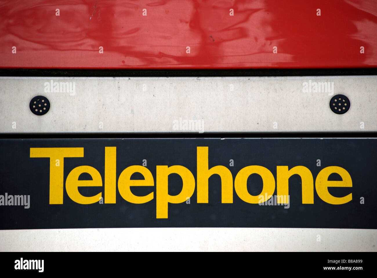 detail of a public telephone box in chiswick high road, west london, england - Stock Image