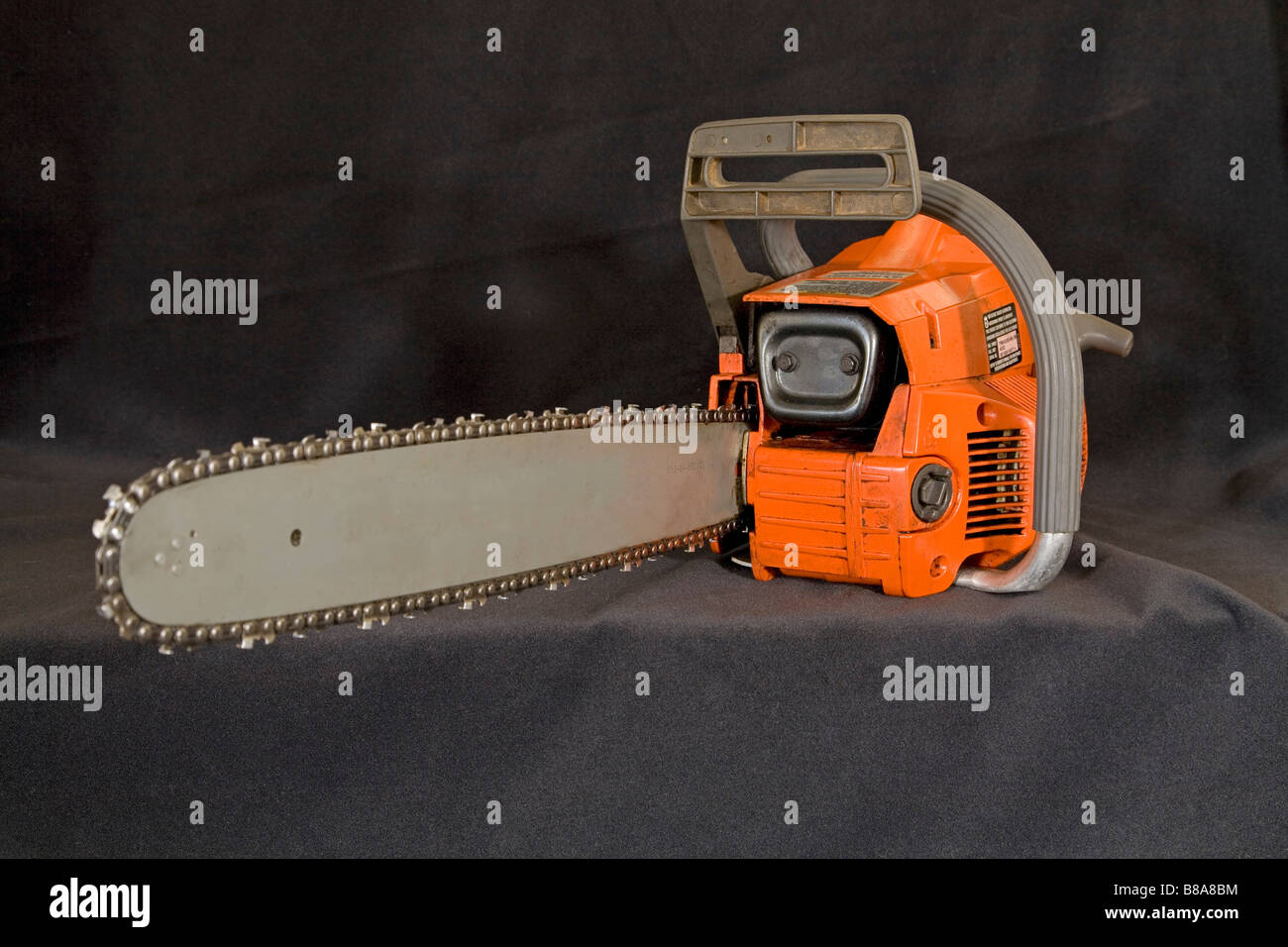 A wood cutter s chain saw or power saw. Stock Photo