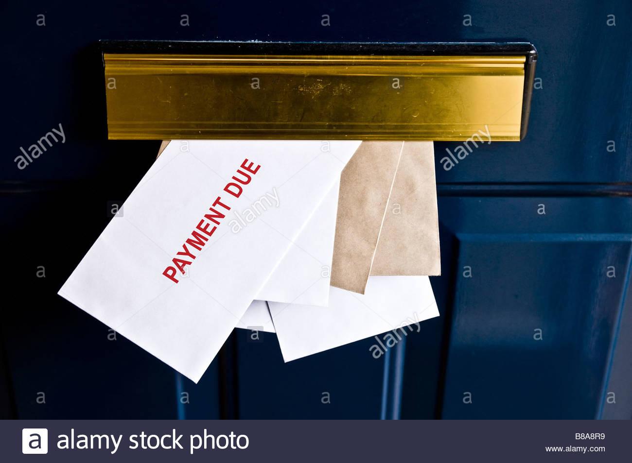 Bills in letter box - Stock Image