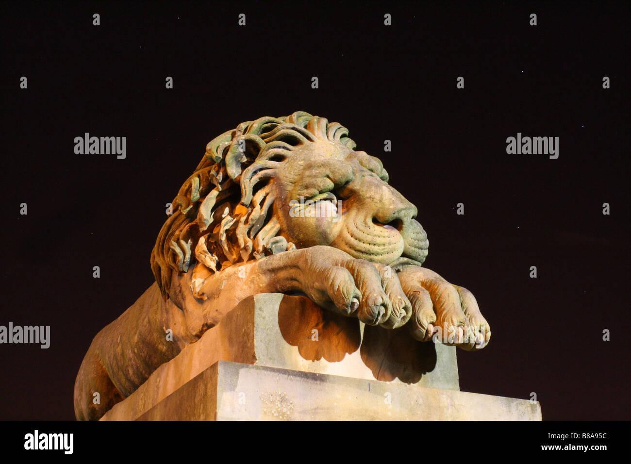Sleeping Lion statue - Stock Image