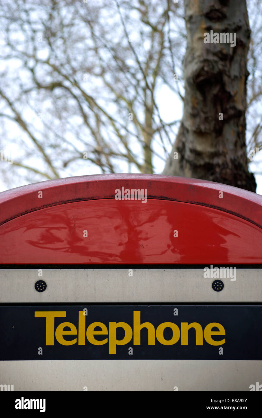 top section of a public telephone box in chiswick high road, west london, england - Stock Image