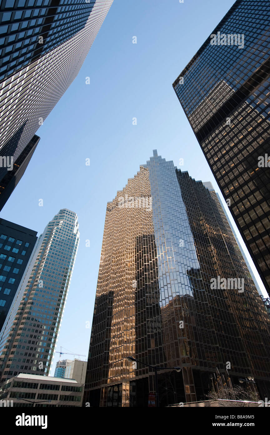 Looking straight up at several highrise office buildings in a downtown area - Stock Image