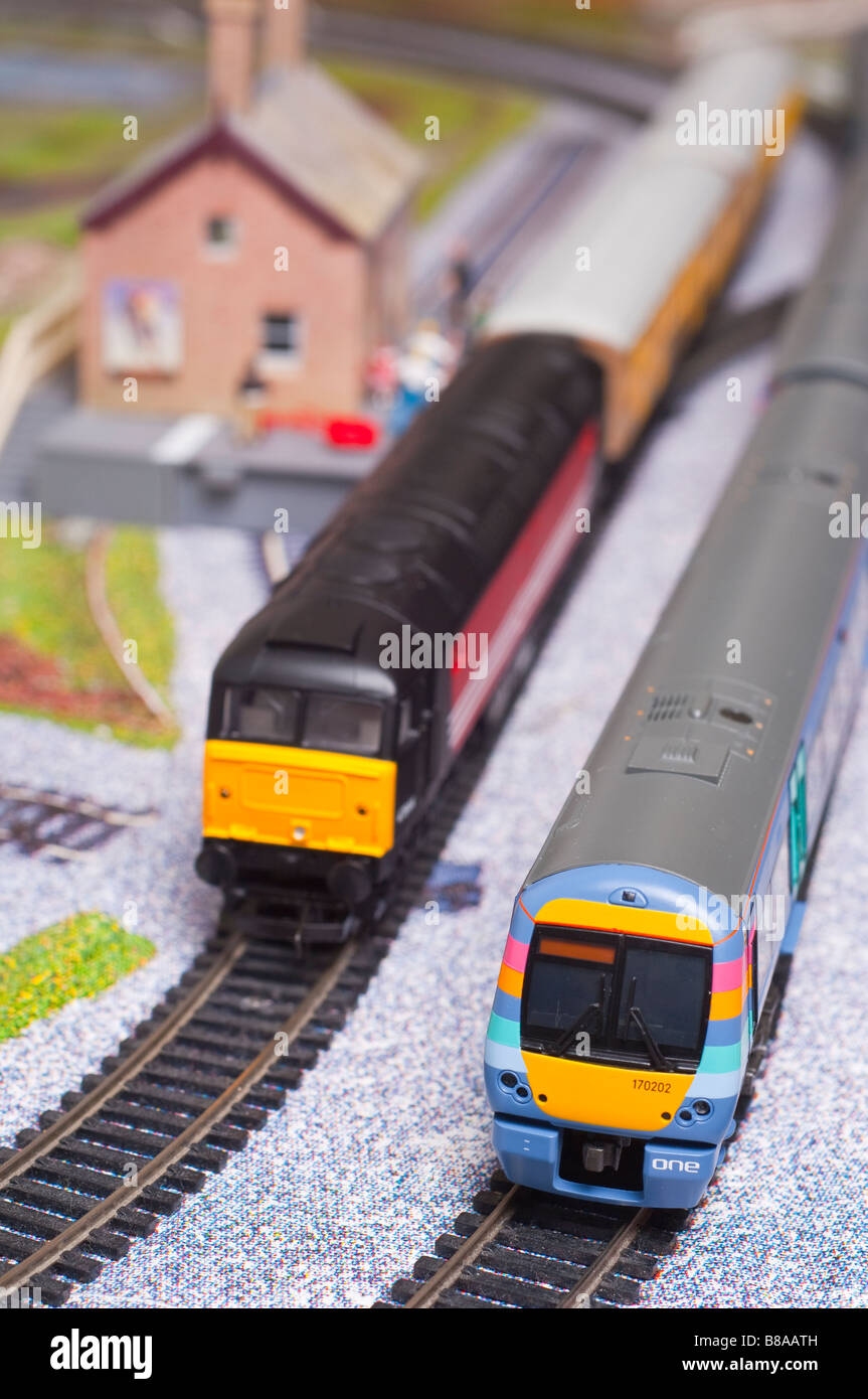 Model toy electric train set in oo gauge with engines from Hornby and Bachmann model railways Stock Photo