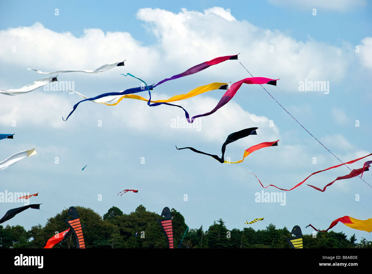 Kite display of colourful ribbon shaped kites taken at the Bristol kite festival, uk in summer. - Stock Image
