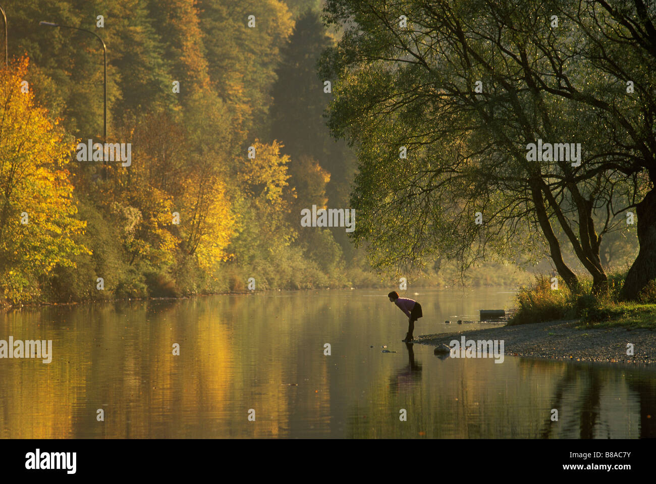The River Semois autumn at Bouillon in the Ardennes Belgium The Japanese poet Machi Tawara looking at the water - Stock Image