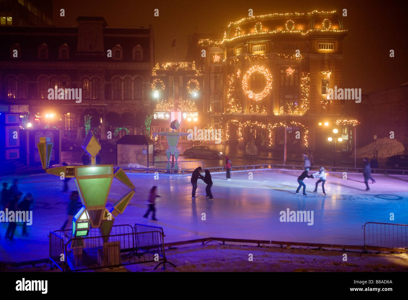 Ice skating at Place Hydro Quebec fronting Capitole de Cabaret Winter Carnival Quebec City Canada - Stock Image