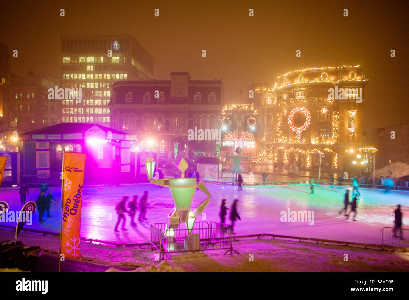 People ice skating at Place Hydro Quebec fronting Capitole de Cabaret Winter Carnival Quebec City Canada - Stock Image