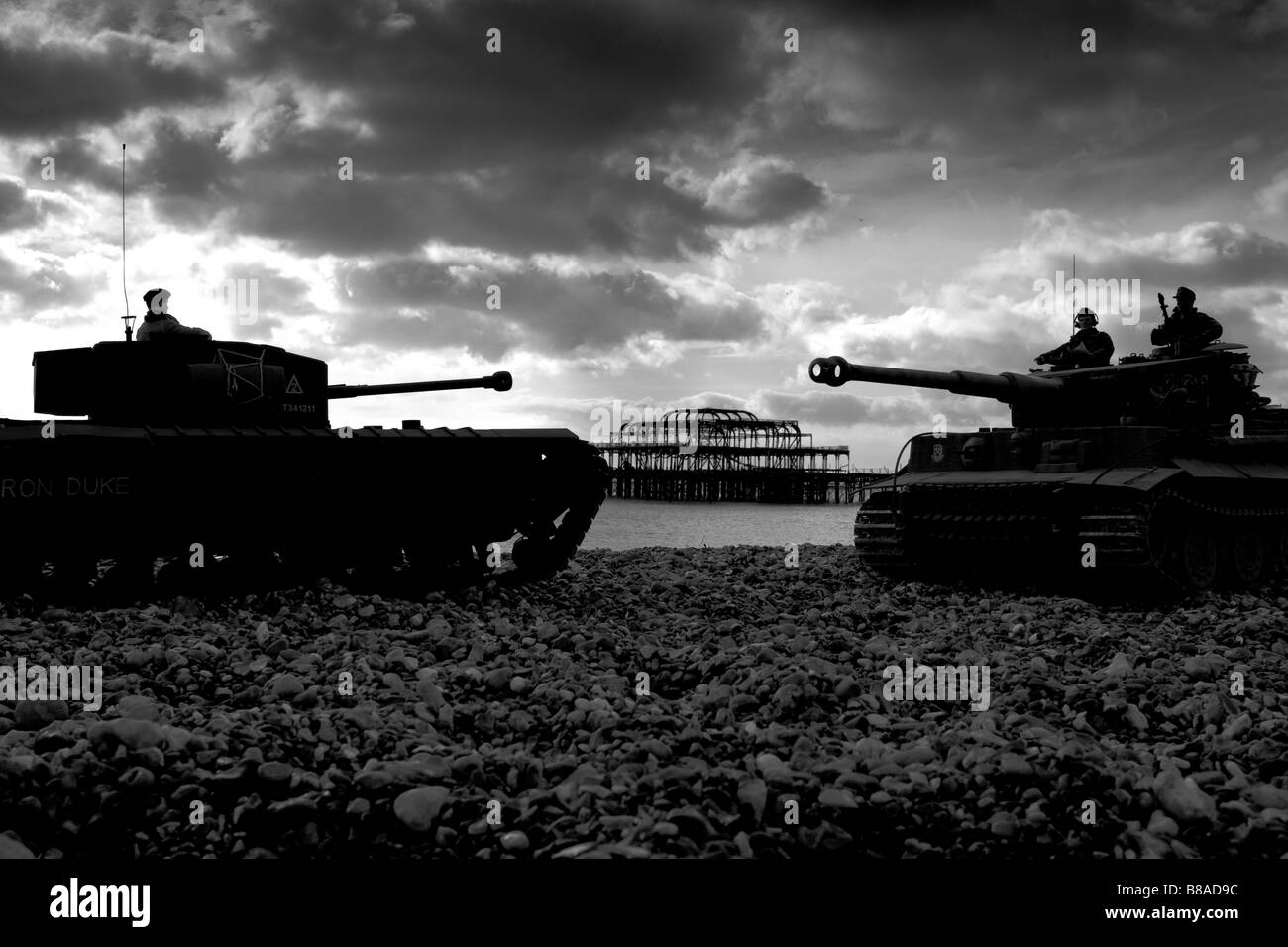 Radio controlled 1 6 scale model British Churchill tank left and German Tiger tank on Brighton beach West Pier in - Stock Image