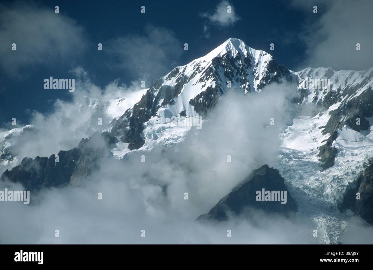 Cloud rising around Mt Illimani north peak, Cordillera Real, Bolivia - Stock Image