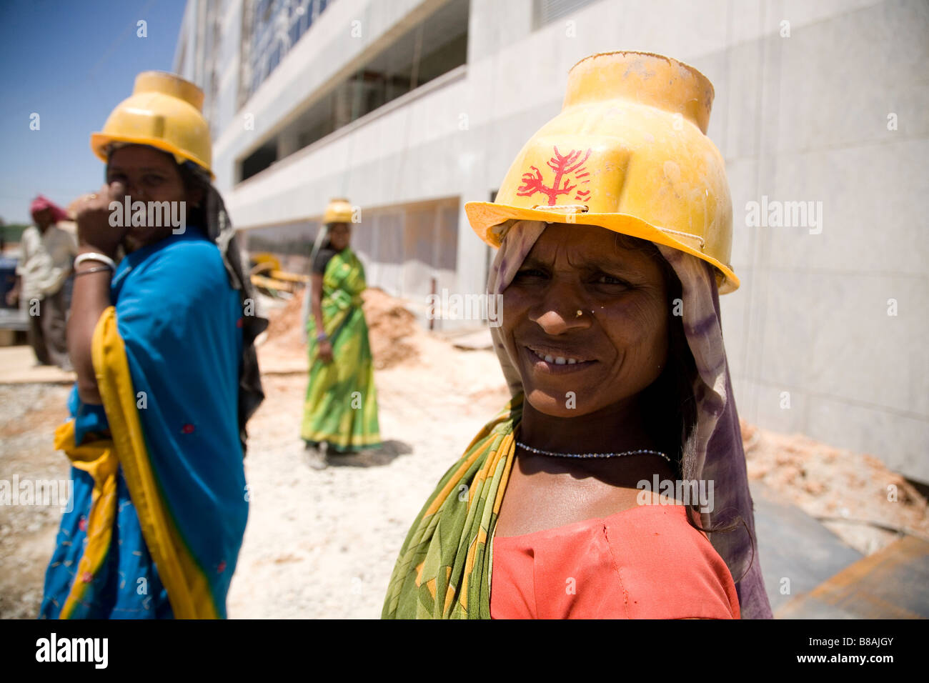 Women in yellow hard hats work on a construction site in Bangalore ... 73f7f137194